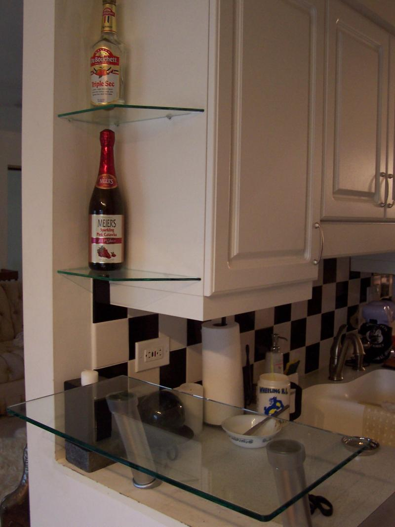 Breakfast bar shelves : ... breakfast bar. ( glass is attached to stainless steel poles using