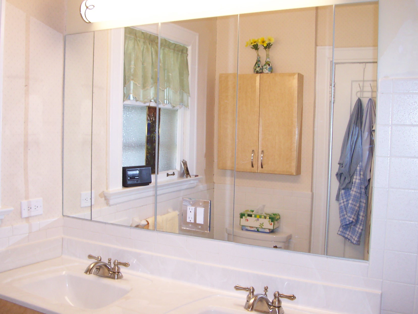Seven piece 1/4 inch beveled mirror adds carachter to this hallway.